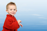 adorable one year old in red sweater on blue sky poster