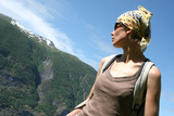 active woman in headscarf on the mountain route poster