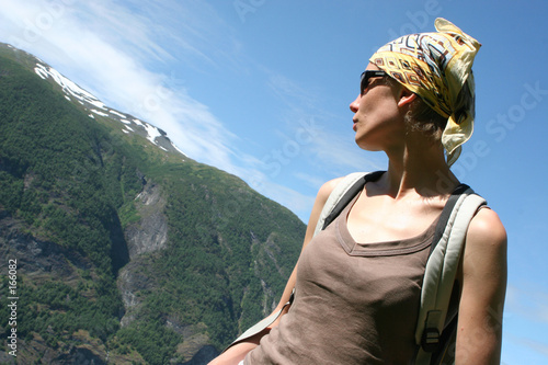 active woman in headscarf on the mountain route