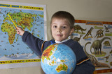 boy with globe poster