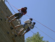 three climbers on belay