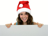 girl wearing christmas hat holding white card poster