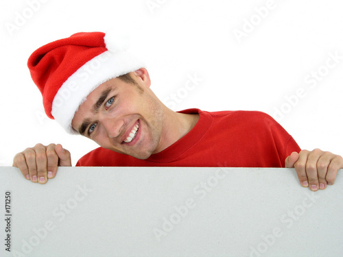 man wearing christmas hat holding white card
