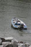 boat leaving shore poster