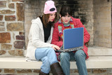 college girls outside with laptop poster