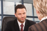 white business man and woman talking in the office poster