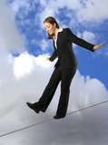 business woman balancing on rope poster