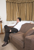business man on a sofa relaxing poster