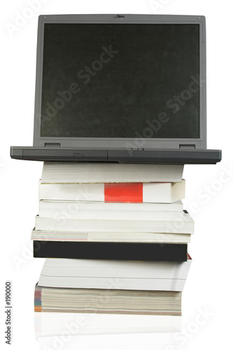 poster of business laptop on top of books