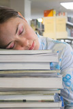 beautiful student sleeping in the library poster