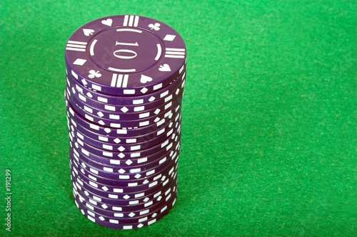 blue pile of casino chips over green