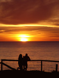 couple enjoying sunset poster