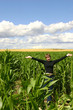 a teenage girl in a cornfield
