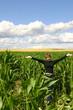 a teenage girl in a cornfield