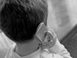 boy talking on phone poster