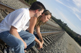 couple on tracks poster