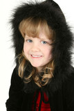 beautiful four year old girl in feather hooded swe poster