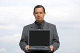 businessman with laptop poster