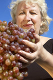 woman with big grape poster