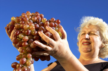 mature woman and grapes