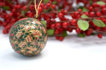 christmas ornament and holly wreath