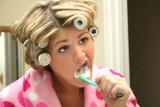 blonde woman brushing teeth poster