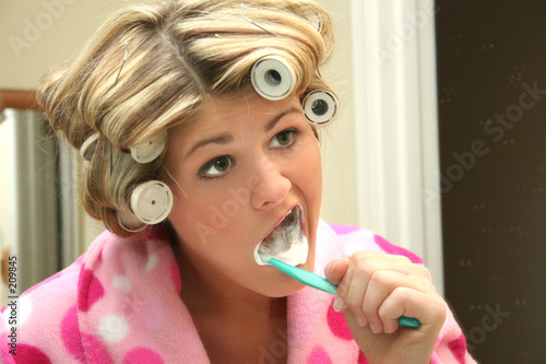 blonde woman brushing teeth