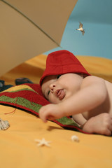baby resting at the beach