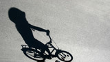 shade of child on a bike poster