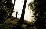 vietnam, hanoi, sword lake: fishing at the sunset poster
