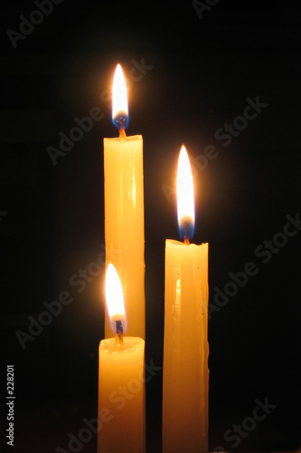 candle against dark background