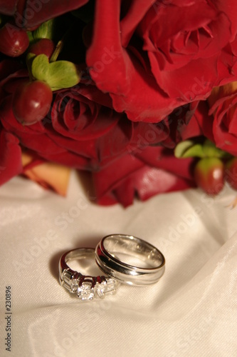 wedding band, rings and red roses