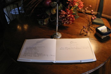 wedding guest book with pen on table