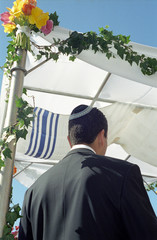 groom under chuppah