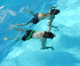 two boys exploring under water together poster
