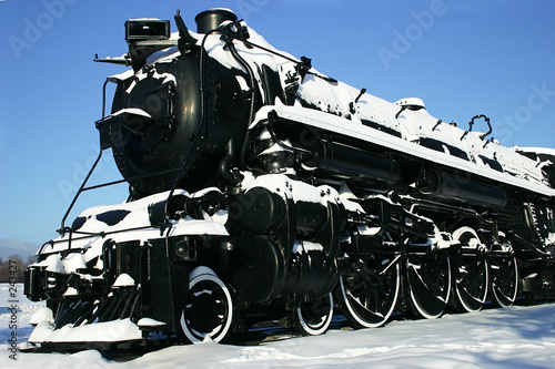 old locomotive covered with snow