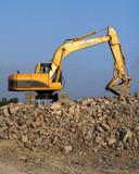 track hoe on rock pile poster