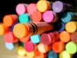 isolated orange crayon