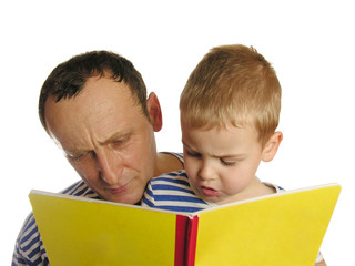 grandfather with grandson read book
