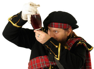 scottish warrior with the bottle of red wine