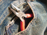 needle nose pliers in front pocket poster