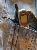 cell phone sticking out of denim jacket pocket poster