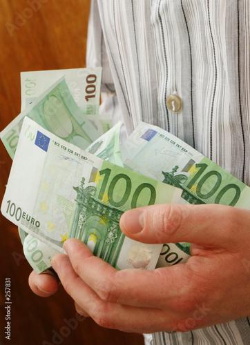 poster of hands full of money