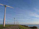 windmills in dutch landscape poster