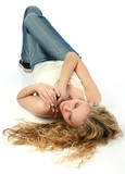 beautiful young woman laying on white floor poster