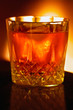warming fireside drink, backlit by the light of th