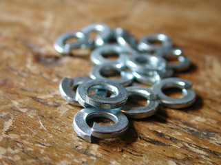 split washers on a piece of wood