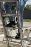 climbing a ladder poster