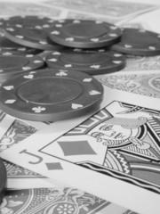 poker chips and deck of cards