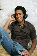 attractive young male listening to music
